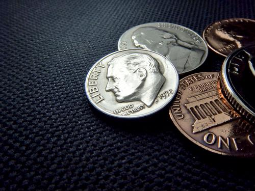Grocers use coin counting machines to offer more services to customers
