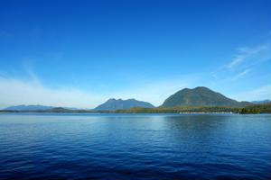View of British Columbia coastline on sunny day -  Travel News