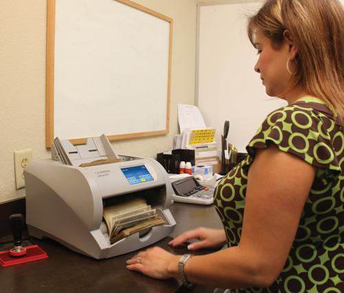 Are dual-purpose cash and check scanners part of a green initiative?