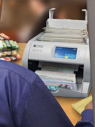 Dual-purpose cash and cheque scanners useful to expanding businesses