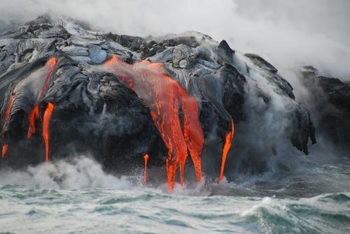 Lava flow in Hawaii threatening homes, commercial activity