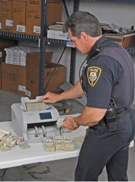 Using money counters to boost law enforcement efficiency