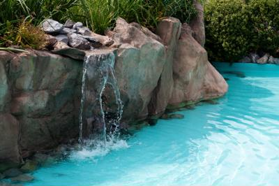 Natural pools, very popular today, blend into their surroundings so they look like they're meant to be there.