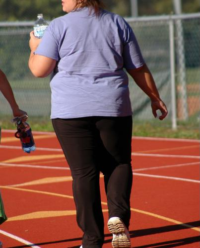 Obesity may be linked to loss of bone and muscle mass.
