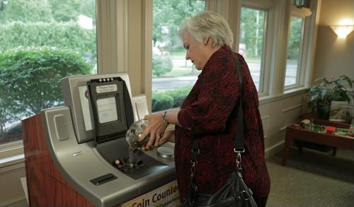 Self-service coin counters enable universal bankers to take hold