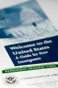 The Obama administration will review the cases of same-sex married couples that were denied green cards.