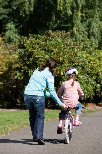 A child may injure her knee if she tries to break on her bike using her leg.