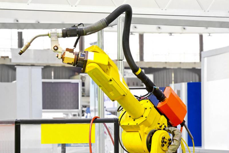 The success of an Atlanta-based textile manufacturing facility that features people and robots working side by side could be a sign that widespread automation may not lead to a major loss of jobs.