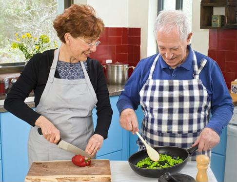 Planning and cooking meals together is a fun way to promote healthy eating for your elderly loved one.