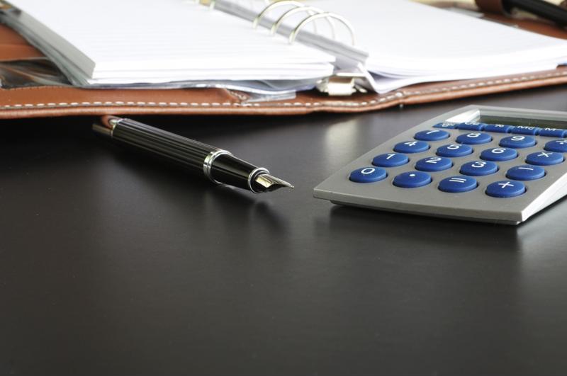 A pen, notebook and calculator.