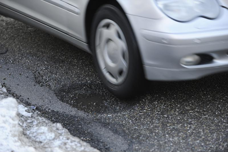 Potholes can cause a lot of damage to your car.