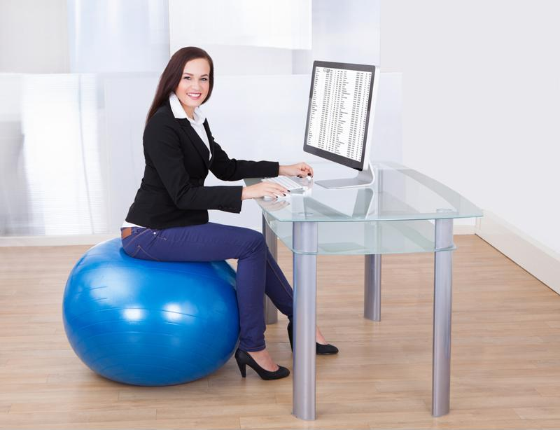 Replace your desk chair with an exercise ball to improve your posture.