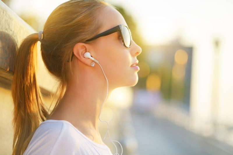 Girl on headphones image