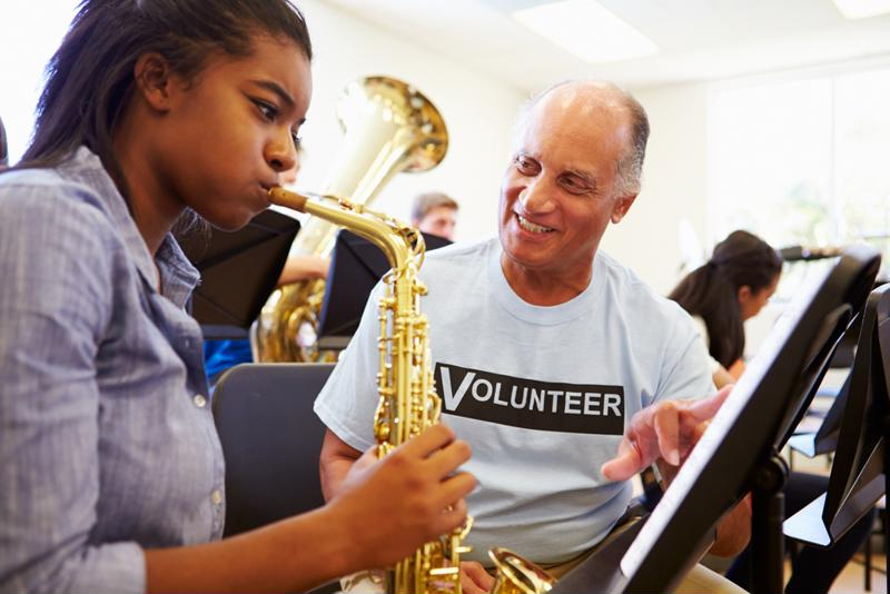 Share your talents with budding musicians in schools.