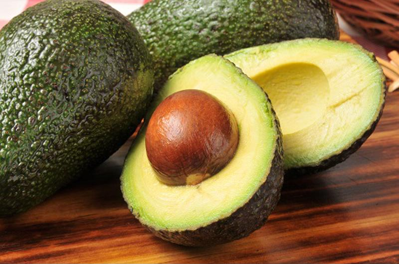 Avoid putting the pits of fruits, such as avocados, down the drain.