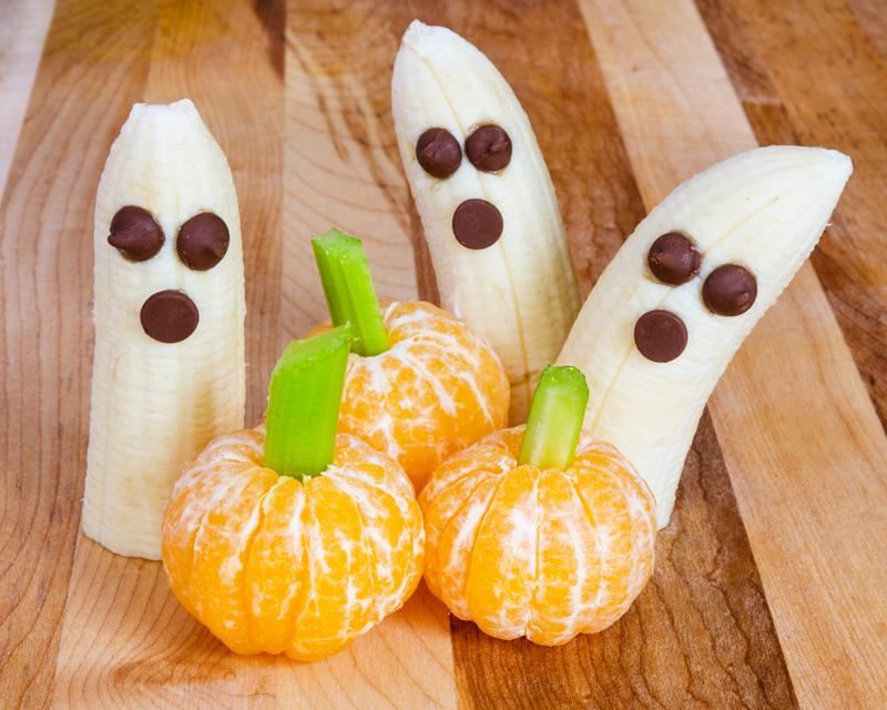 A tangerine pumpkins and ghosts platter will be the life of any Halloween party.