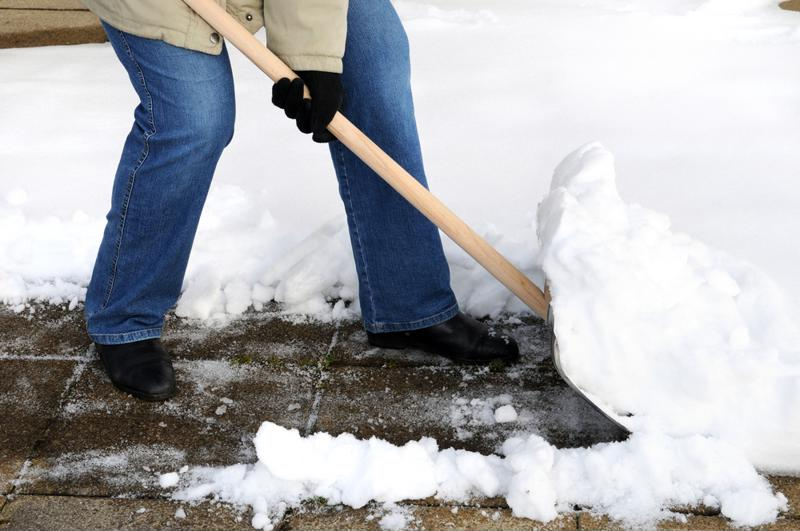 Shoveling snow requires great attention and safety.