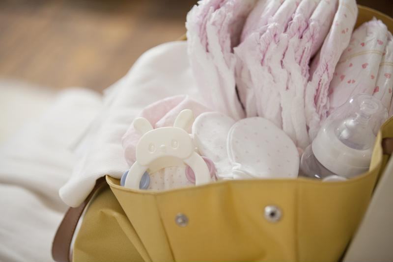Buy a diaper bag with plenty of compartments inside.