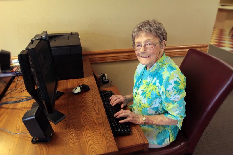 Edgewood senior working on computer.
