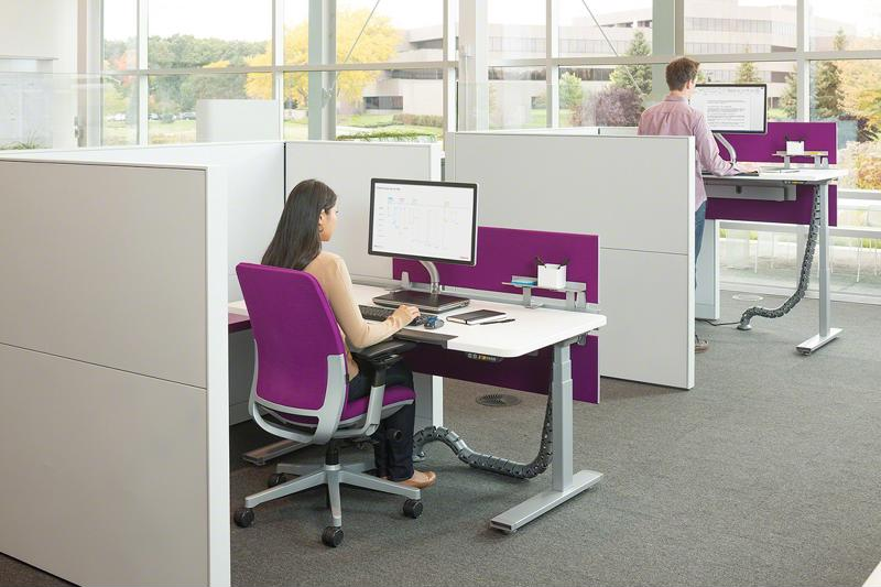 Office Designs carries the Herman Miller Renew sit-to-stand table, an adjustable height desk that lets one go from sitting to standing in seconds.