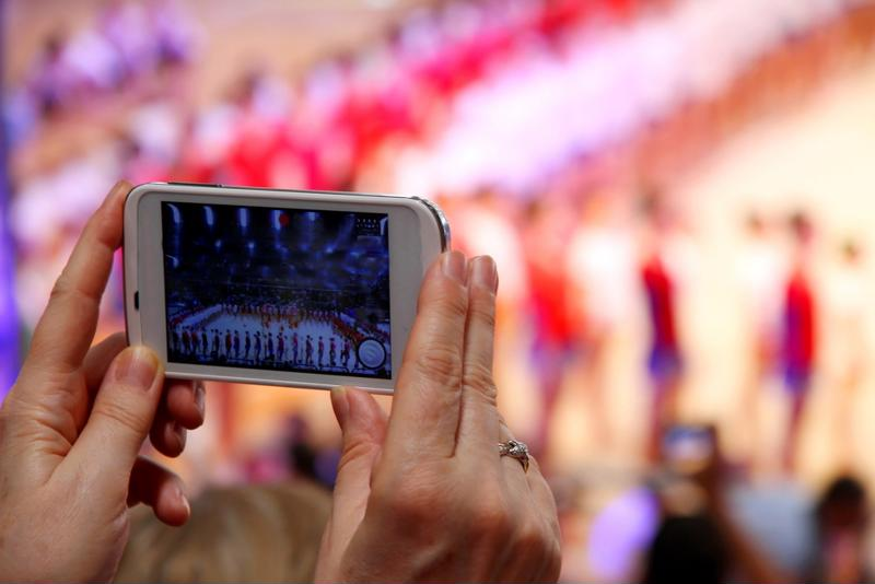 Somebody filming and sharing video is an increasingly common site at sporting venues.