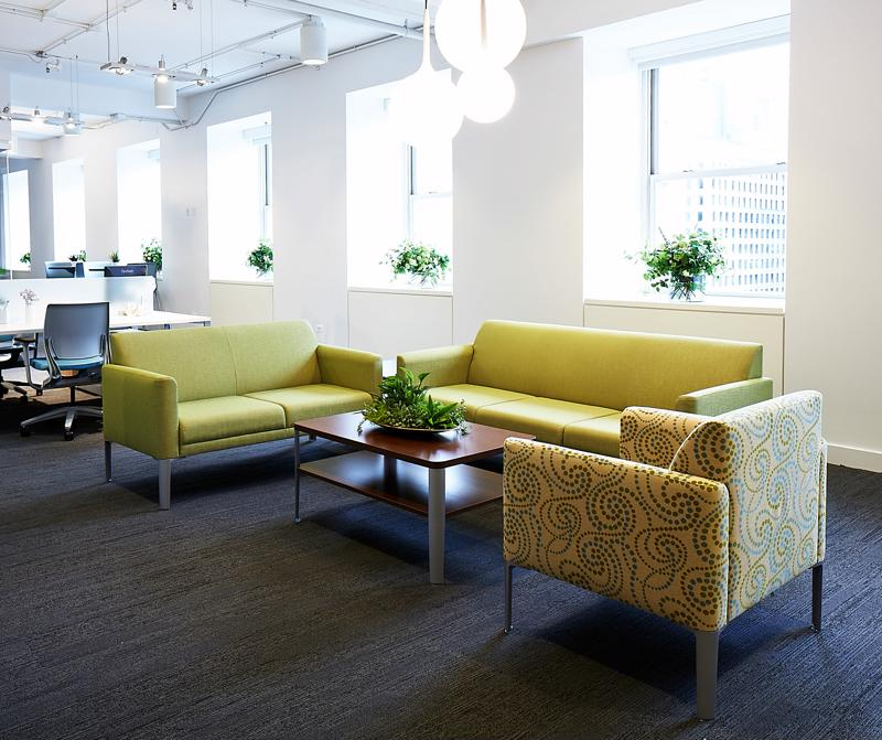 A seating area for guests to relax in can help make the office more inviting and welcoming.