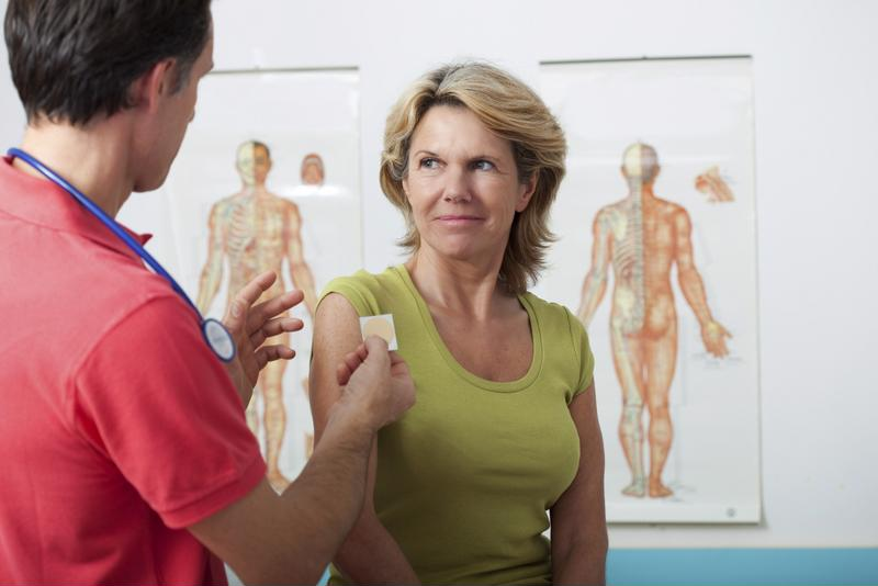 Nurse speaking with female patient.
