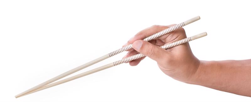 Gently pinch your food with the chopsticks.