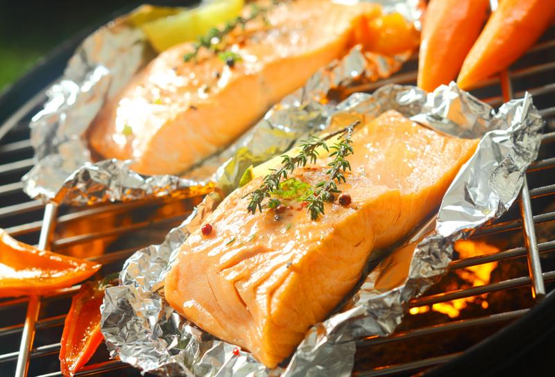 Vacuum seal preseasoned fish to prepare them for the grill.