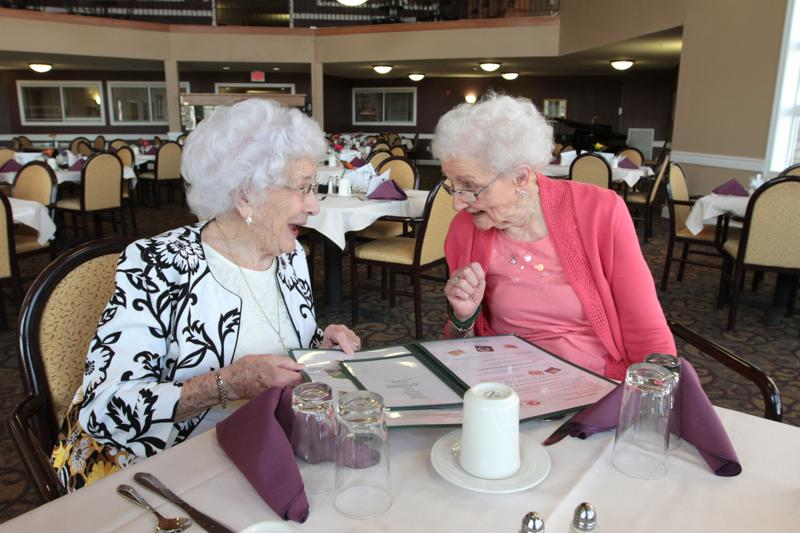 Seniors can eat with their friends in the community dining room.
