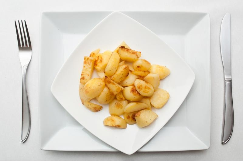 Give your guests a heated kick with spicy seasoned potatoes.