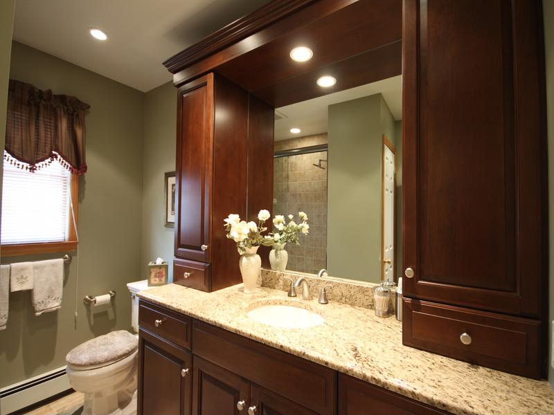 These beautiful cabinets provide extra storage space and add style to the bathroom.
