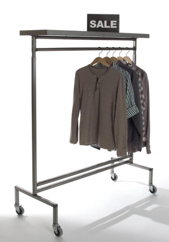 Raw steel rolling racks can display shirts with matching shoes on the top shelf.