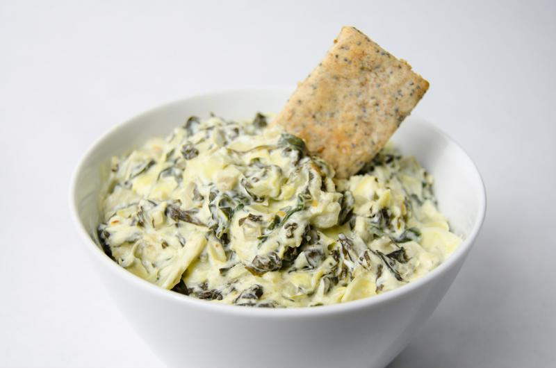 Spinach artichoke dip is a crowd favorite for any football game.