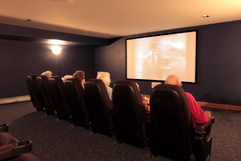 Seniors watching film in theater.
