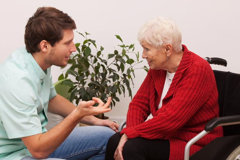 Health care worker talking to senior.