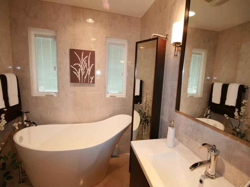 This modern design of a clawfoot tub adds style and beauty to this bathroom remodel.