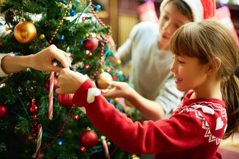 Decorate the tree as a family to get everyone into the holiday spirit.