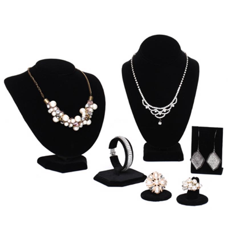 Black velvet displays make silver jewelry pop.