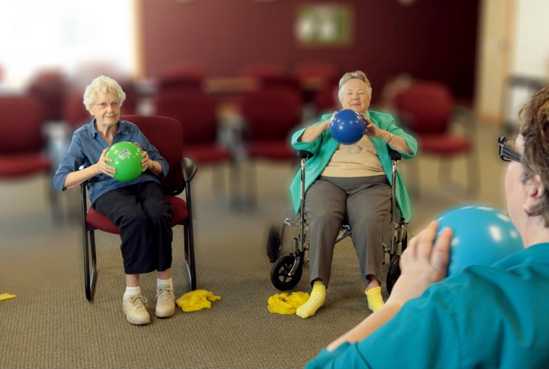 Seniors working out in Edgewood group exercise class.
