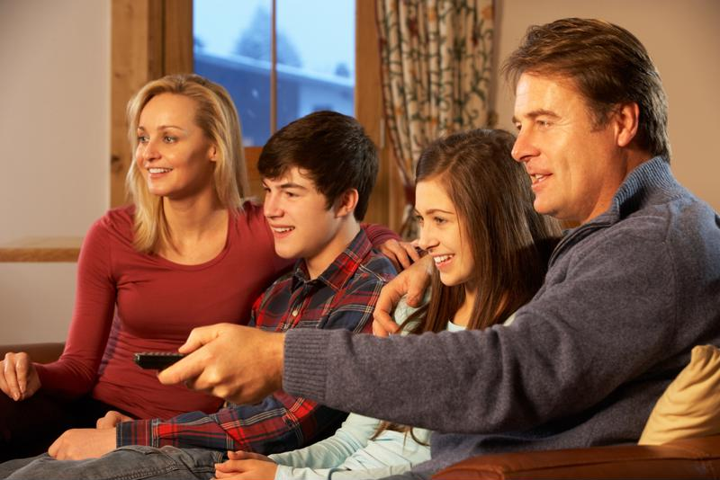 Family watching streaming video.