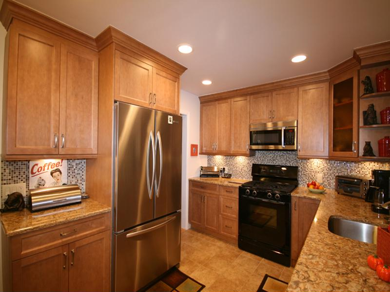 This kitchen remodel is an example of how maple makes beautiful cabinets.
