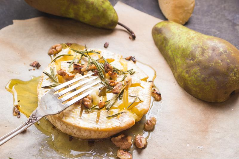 You can jazz up Brie cheese with almost anything, but pears and pistachios are truly great.