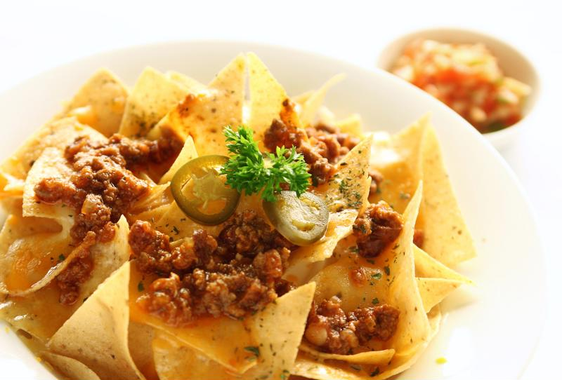 Spicy beef chili goes perfectly with tortilla chips.