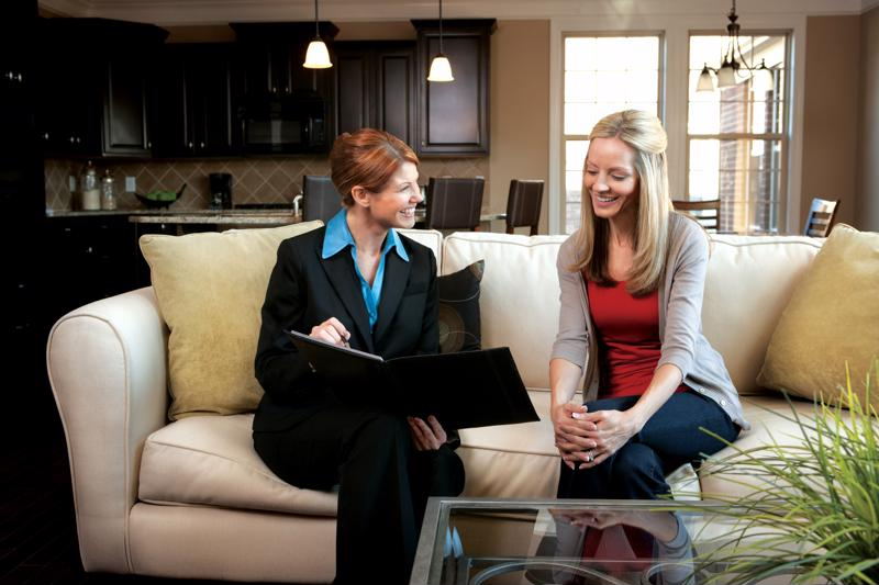 A young woman talking to a realtor.