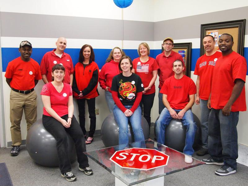 National Marker Company supports heart disease awareness month by wearing red.