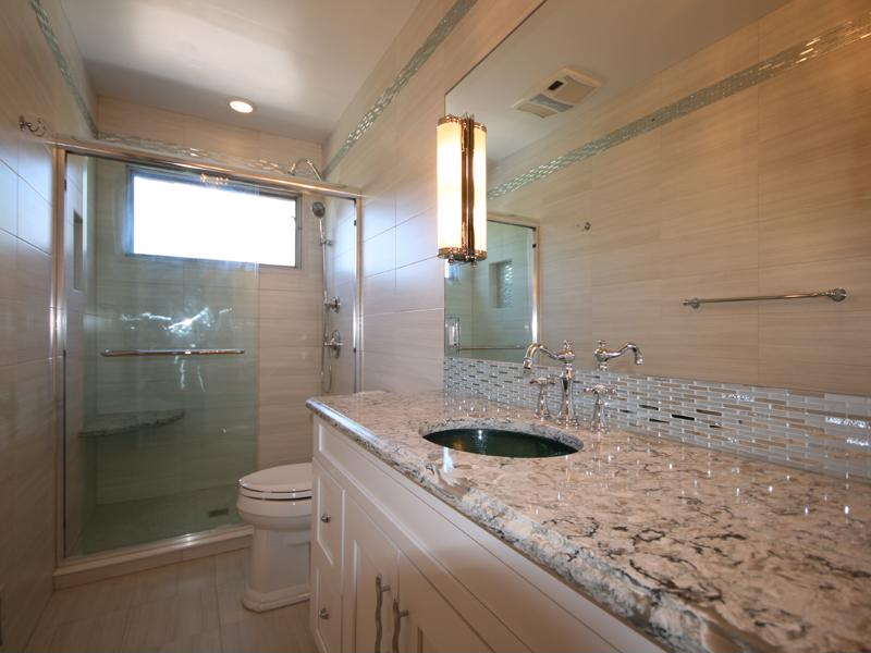 Small bathroom windows set high in the room provide light without compromising privacy.