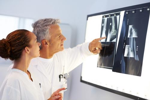 Orthopedists perform various functions, including assessing x-rays to the nature joint injuries.