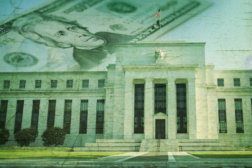 Fed lowers rate, faces growing policy divide