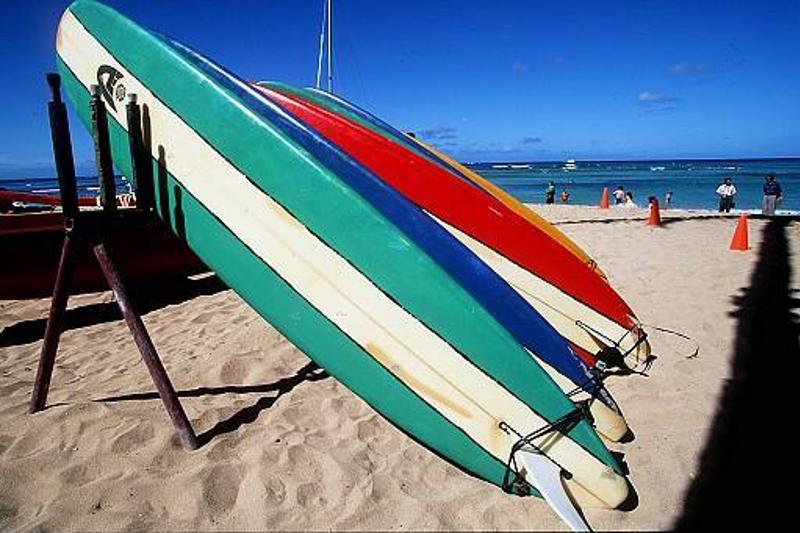 Grab a surfboard and experience the sand and surf at Waikiki.